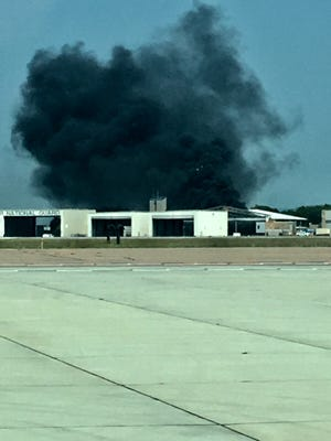 Smoke billows out of the Vermont Air National Guard base on Monday, August 6 2018
