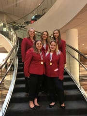 Left to right (top) at the National Conference of the FCCLA are Polytech students and award winners: Madison Trevaskiss, Meadow Jacobson, Alyssa DeBiasio, (bottom) Rosa Castaldo and Heather Kelly.