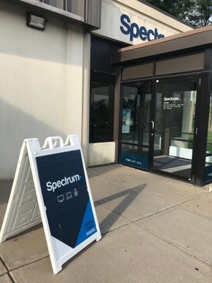 The entrance to the Charter Spectrum office in Vestal, New York. The company is under siege in New York as regulators pressure the cable provider to forfeit their business in the state.