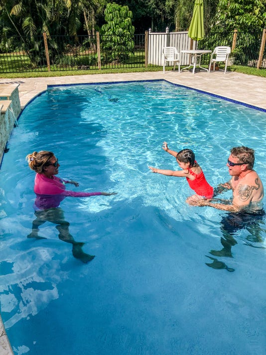 0830-JCNW-Swimming-adults-child-in-pool.jpg