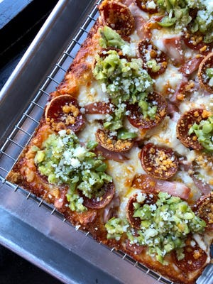 The stunning Emmyletta, served only in the East Village location, is a Detroit pizza with the components of New Orleans' famous muffuletta sandwich on it: mortadella, pepperoni and giardiniera-style olive salad.