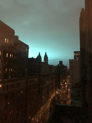 This photo shows blue light over New York, as seen from Manhattan Brough of New York on Thursday, Dec. 27, 2018. New York police said a transformer exploded at a Con Edison facility in Queens on Thursday, causing some power outages.