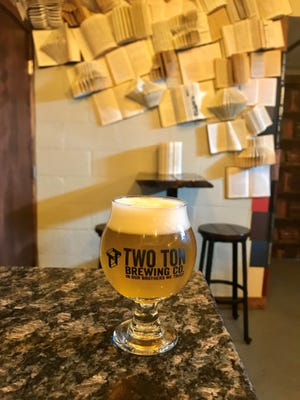 Inside Two Ton Brewing's library speakeasy.