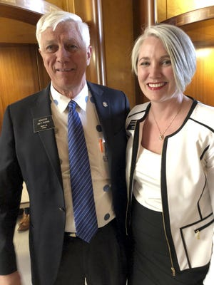 Sen. Jim Roers, left, and his daughter, Rep. Shannon Roers Jones, pose for a photo at the state Capitol in Bismarck, North Dakota, Tuesday, March 19, 2019. Roers Jones of Fargo pushed successful legislation to repeal the state's longstanding Sunday business restrictions that are rooted in religious tradition. Jim Roers voted against the repeal in 2017 but changed his mind after pressure from constituents and his daughter.