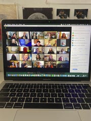People gather on Zoom, a video conferencing app. Companies and friend groups across the U.S. are video chatting to keep spirits high.