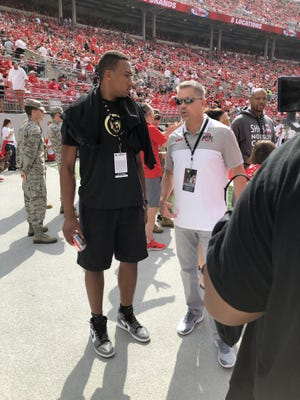 Incoming freshman Zed Key Jr. of Bay Shore, New York, attends Ohio State's football game against Cincinnati with coach Chris Holtmann on Sept. 7, 2019.
