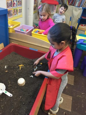 A student learns about dirt, animals and tractors during the winter months.