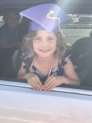 Incredible Years Preschool student Kamri enjoys a drive-thru graduation ceremony in Great Bend. She was one of 10 students celebrating with the Sunflower Diversified Services organization which serves five south-central counties.