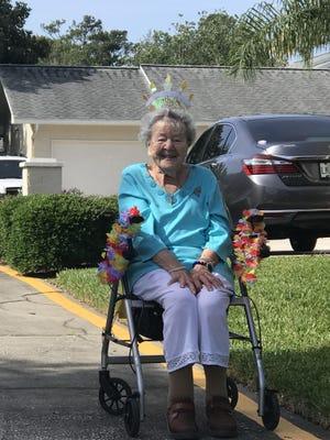 COA senior center participant, Ollie, celebrates her centenarian birthday with a birthday caravan from friends.