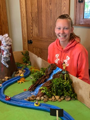 West Branch Middle School student Brynn Smith shows off the Disney water ride she created as part of a STEM lesson during the homeschooling COVID-19 pandemic.