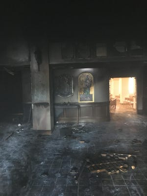 The Marion County Sheriff's Office provided this photo of the inside of Queen of Peace Catholic Church, where a man set a fire on July 11. No one was injured.