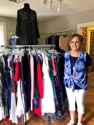 Katina Beitzel, store manager of REVIVAL, an upscale consignment boutique (located inside Abigail Birch in Historic Roscoe Village) featuring women's, plus size women's, juniors, children, infants, men's, purses, jewelry.