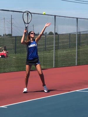 Cambridge's Gabby Porter prepares to serve during Monday's season opening tennis match with West Holmes at Cambridge City Park. The Lady Bobcats opened the season with a pair of wins.