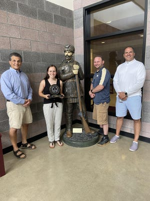 Stroudsburg High School senior Avery Francis, second from left, is the female winner of the 2019-20 EPC Sportsmanship of the Year Award. Flanking Francis from left are EPC SAC Council Chairman Rusty Amaro, Stroudsburg athletic director Sean Richmond and principal Jeff Sodl.