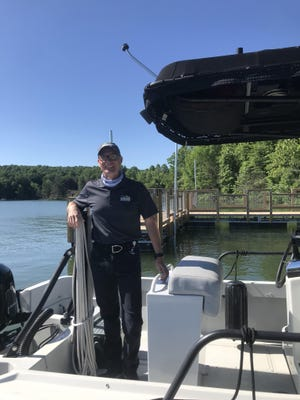 New Muskingum Watershed Conservancy District Chief Executive Officer Craig Butler looks over the handicap accessible fishing pier at Atwood Lake. It's located at the public launch ramp off of State Route 212 near Sherrodsville. Photo courtesy of Adria Bergeron