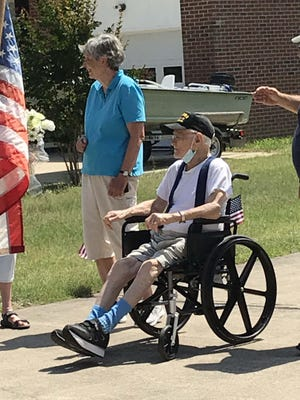 Fairfield Harbour WWII veteran John Hardy received a hero's welcome from friends and neighbors on his recent arrival home from the hospital. He is shown here with his wife Jane as they enjoy the celebration. Photo courtesy of Marty Dzioba.