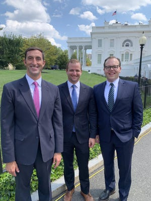 John Persinger, from left, president of the Erie Downtown Development Corp., is photographed outside the White House Monday with Special Assistant to the President Ben Hobbs and Matt Wachter, vice president of finance and development for the EDDC.