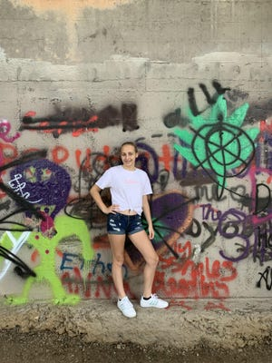 Amy Brandon took this photo of her daughter Kenslee Brandon during a recent trip to visit friends in Kentucky. She loved this graffiti wall and had her mother stop to take many pictures in front of it, Amy said.