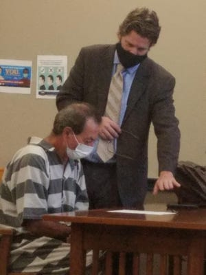 Adam Soto (seated) confers with public defender Christopher DeLisio in New Philadelphia Municipal Court in August.