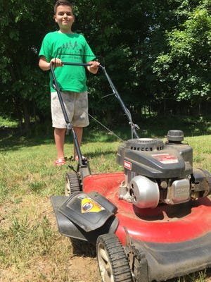 """Norwich resident Nathan Concepcion, 14, recently finished a """"50-lawn"""" volunteer mowing challenge."""