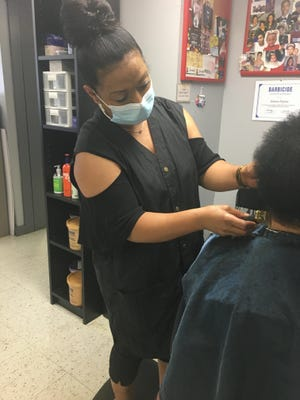 Helena Depina, owner of Helena's Hair Palace, said doing business during the COVID-19 pandemic has been harder than when she first started in the industry 30 years ago.