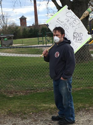 Plainfield resident Dan Reale protesting on April 28 at Lions Park.