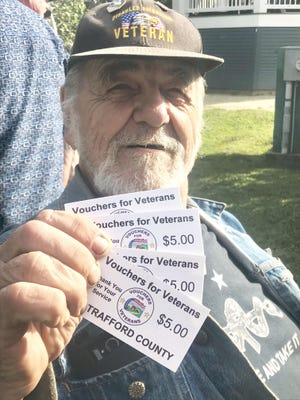Graham Matthews, a Rochester resident and disabled Vietnam veteran, poses with his Vouchers for Veterans vouchers during a Rochester Farmers Market last September. The nonprofit program is expanding into Portsmouth this year and adding Dover as another Seacoast option.