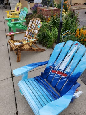 """A live auction for 20 artist-painted Adirondack chairs is planned for 6 p.m. Saturday in downtown Canandaigua as part of the Adirondack Chair """"ity"""" Auction."""