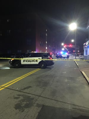Norwich police outside the ArtSpace Norwich Apartments complex on Franklin Street Tuesday night.