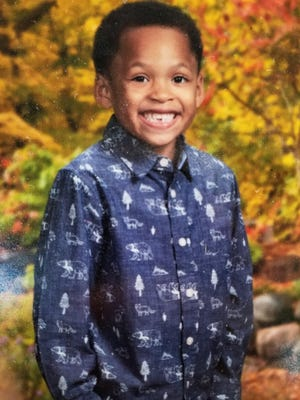 King Pleasant, 6, smiles for a school photo.