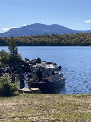 The Maine Warden Service Dive boat, pictured on Flagstaff Lake near Long Falls Dam as they search for a missing York woman on Sunday, Sept. 20, 2020.