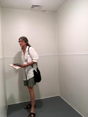 Carol Brown of Race Matters, Friends examines the seclusion rooms last year at the Center for Responsive Education's FOCUS program, operated by contractor Catapult Learning in the building owned by Columbia Public Schools.