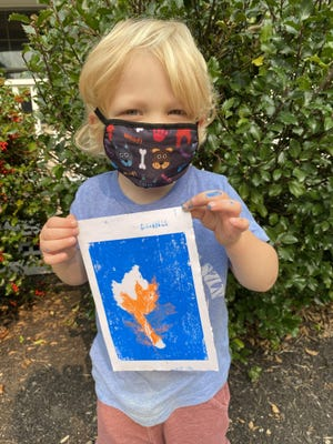 Sebastian Cavaretta, 3, of York, tries his hand at leaf printing, one of the many workshops taught during the Open-Air Fall Arts Festival at Ocean Fire Pottery in York, Maine.