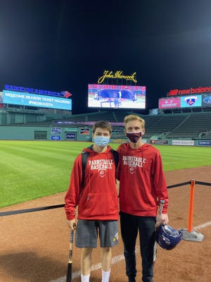 Barnstable baseball players Mike Meagher, left and Casey Proto, took some swings at the fabled outfield wall last week at Fenway Park. [Barnstable Athletics}