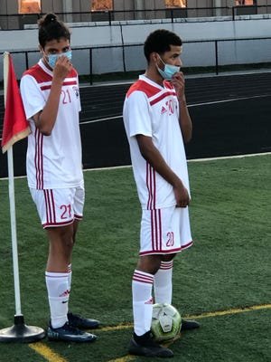 New Bedford's Luis Neto, left, and Ronaldo Ramos prepare for an indirect kick during a 3-1 road win over Durfee on Friday.
