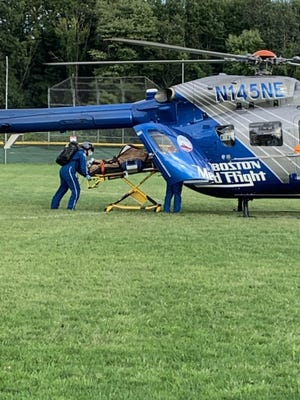 A 13-year-old boy is loaded up on a medical rescue helicopter after he was seriously injured in a car vs. bike crash in Wayland on Tuesday.