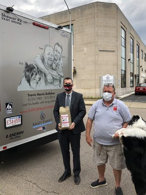 """With his recent expansion into a coffee line, Peter Kelleher, known as the """"Soupman,"""" recently presented a bag of his Brockton Blend coffee to Brockton Mayor Robert Sullivan. Outside of coffee, his mission to help the homeless may soon continue in the form of a food pantry in the city."""