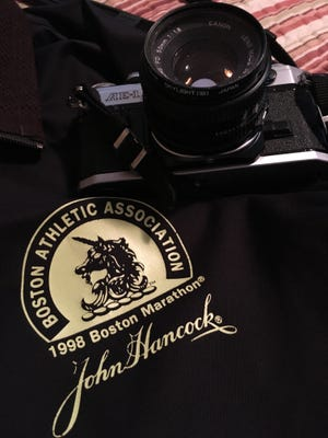 The author still has the camera, now fixed, and jacket from when he covered the Boston Marathon in 1998.
