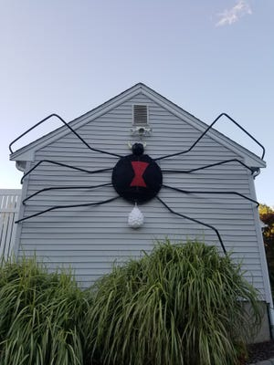Tim Isaacsen makes his own DIY Halloween decorations, like the spider on the side of his house on Burt Street.