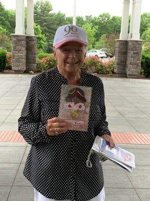 Irene Pond of Franklin, who turns 90 on June 13, shows one of the surprise birthday cards she recently received in the mail. She has been pleasantly surprised by a flood of birthday cards that have been arriving for her at Franklin's Magnolia Heights. It's all part of a campaign started by one of her daughters, Suzanne Marchesano, to get at least 90 cards sent to her mother to make her landmark birthday extra special.