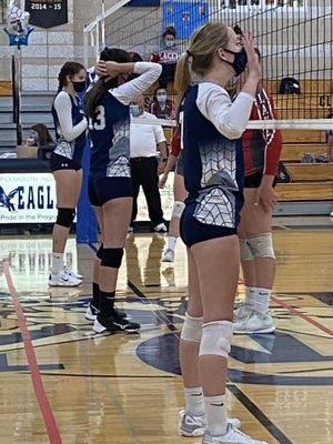 Morgan Moscato (13) and Mandy Drew (7) get into position at the net.