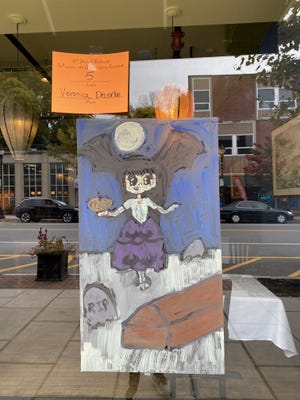 The annual Halloween window painting contest in Belmont Center recently took place on Oct. 24. Pictured, is the work by Veronica Decerbo, one of the winners.