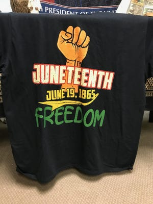 "A Juneteenth T-shirt at the ""The Visual Center for the Black American Experience"" displayed at the Unitarian Universalist Church in Brockton on Aug. 10, 2018. A celebration of Juneteenth is being held outside City Hall at 6 p.m. on Friday, June 19, 2020."