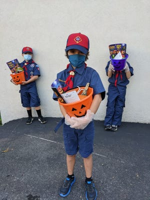 """Members of Quincy's Cub Scout Pack 42 helped assemble the """"Boo Buckets"""" for Interfaith Social Services. Photo from Interfaith Social Services."""