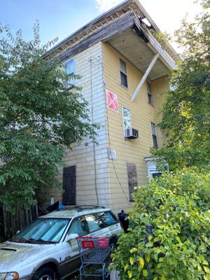 The condemned multi-family home located at 11 Charles Street will be demolished by the City of Beverly.