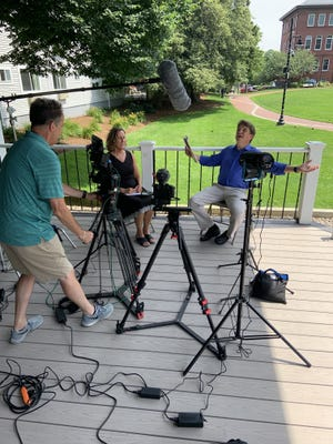 Mary Lenihan, treasurer of the Arts Foundation of Cape Cod, talks with Keith Lockhart, conductor of the Boston Pops, on the Hyannis Green while they filmed a segment for this summer's virtual version of Citizens Bank Pops by the Sea.