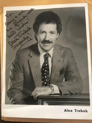 The autographed photo that Gary Susswein got in the mail from Alex Trebek in 1986 after Susswein left a note for Trebek at his Beverly Hills haberdasher.