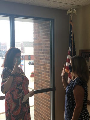 Canton City Clerk, Diana Pavley-Rock, is pictured administering the oath of office to Alderwoman Andra Chamberlin.