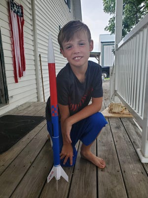 4-H member Brayton McCoy is pictured with his 4-H aerospace project.