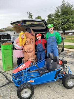 The Brainard family went all out Sunday for the trunk-or-treat event at the Eagle's Club in Freeport. About 15 vehicles showed up to hand out candy to kids and help them get into the Halloween spirit.